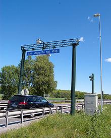 Automastiske bomstasjonr -- denne ved Auli i Tønsberg -- er blitt en erstatning for en statlig infrastrukturpolitikk for veinettet.